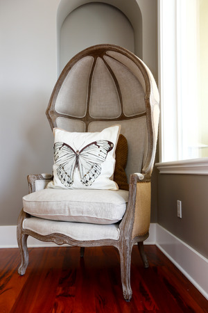 american butterflies: Antique hood chair with white butterfly pillow in luxury house