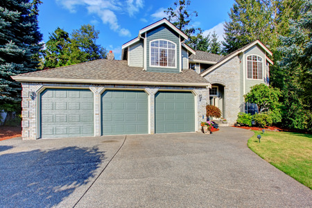 garage on house: Luxury house exterior with three car garage and driveway Stock Photo