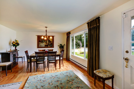 Dining rooom with hardwood floor and dining table set photo