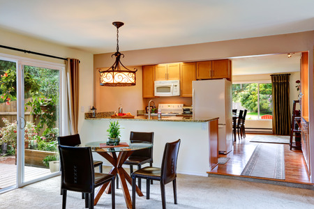 dining table and chairs: Bright kitchen room with walkout deck, glass top dining table and chairs