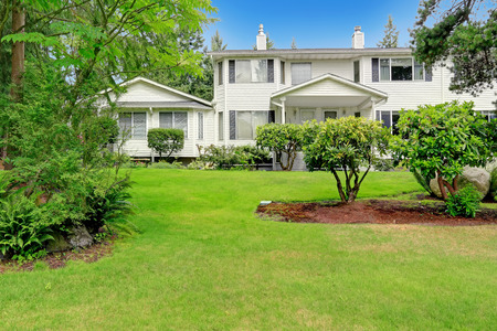 curb: Classic american house with entrance porch and curb appeal
