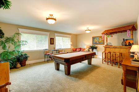 Entertainment Room In Hawaian Style With Pool Table, Crafted Wooden Bar  With Rustic Stools And