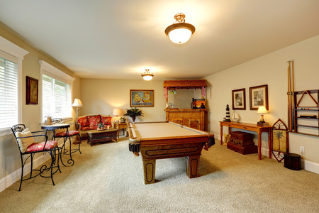 pool table: Entertainment room in hawaian style with pool table, crafted wooden bar with rustic stools and palm trees