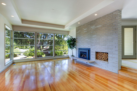 trim wall: Empty house interior  Living room with glass wall  View of brick wall with fireplace Stock Photo