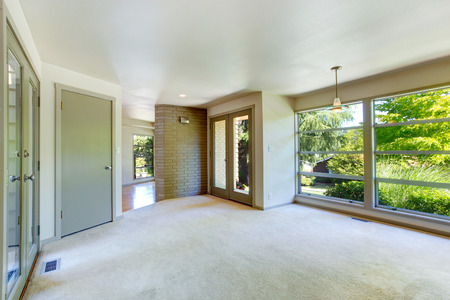 trim wall: Empty house interior  Room with brick wall trim and glass wall  Stock Photo