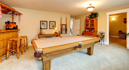 Beau Entertainment Room In Hawaian Style With Pool Table, Crafted Wooden Bar  With Rustic Stools And