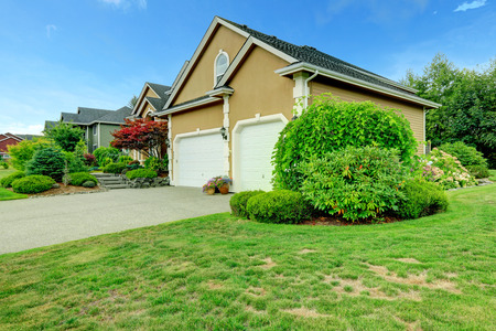 two car garage: House exterior. View of two car garage with driveway Stock Photo