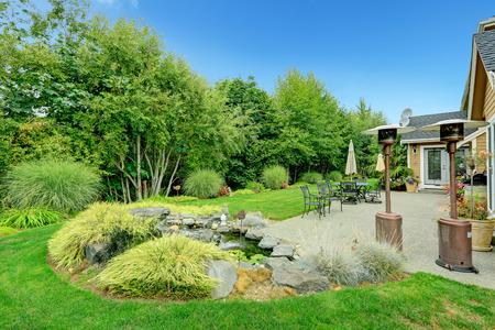 Patio area on walkout backyard deck with beautiful landscape