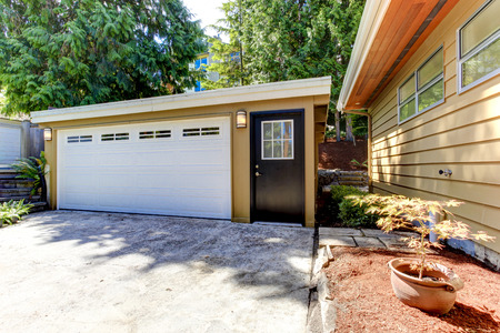 garage on house: House exterior. View of garage and driveway