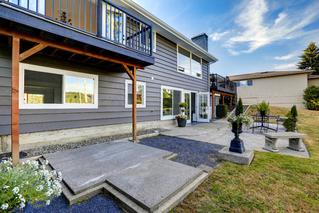 porches: House walkout deck with flower pots, stone bench and patio area