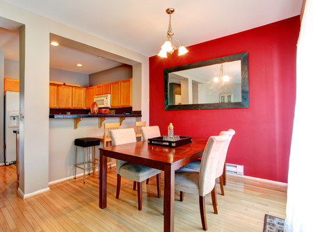 House interior. Kitchen and dining room with contrast red wall. photo