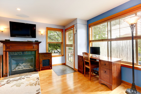 Living room with fireplace, TV and offiece area photo