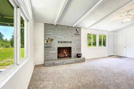 fireplace living room: Empty living room with fireplace and soft carpet floor Stock Photo