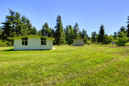 countryside landscape: Simple house exterior with  shed. Countryside landscape Stock Photo