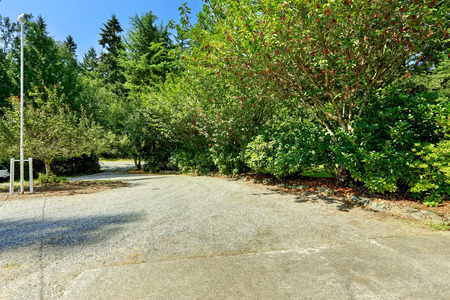 Gravel driveway. Countryside landscape during summer
