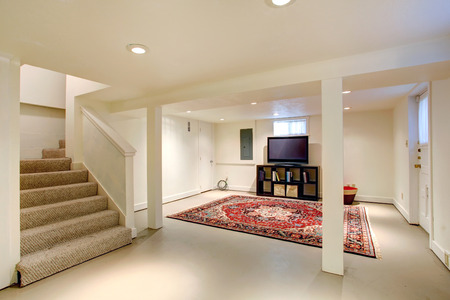 empty house: House interior. Ideas for basement room. Entertainment room with tv