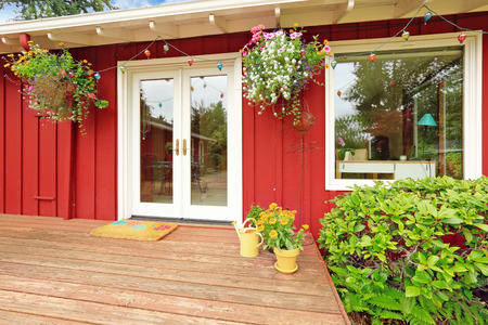 american house: Bright red classic American house entrance porch with brick trim and white entrance porch Stock Photo
