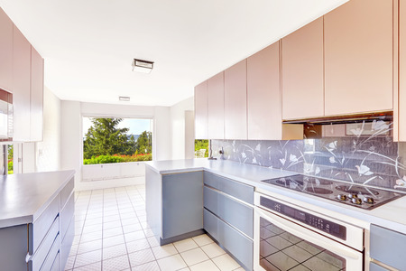 build in: Antique Kitchen room with blue and pink storage combination, decorated back splash. Unique modern old home build in 1952.