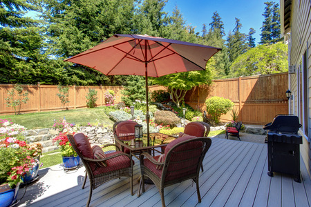 Beautiful landscape design for backyard garden and patio area on walkout deck photo