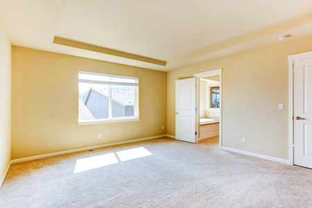 master bedroom: Bright room in empty house. Master bedroom with bathroom