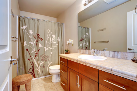 bathroom mirror: Bathroom interior in soft ivory color with wooden vanity cabinet and large mirror Stock Photo