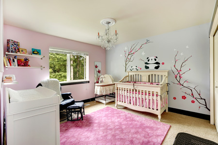 nursery room: Nursery room interior in light blue and pink colors with painted wall.