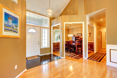 shiny floor: Hight ceiling foyer with shiny hardwood floor. View of dining area