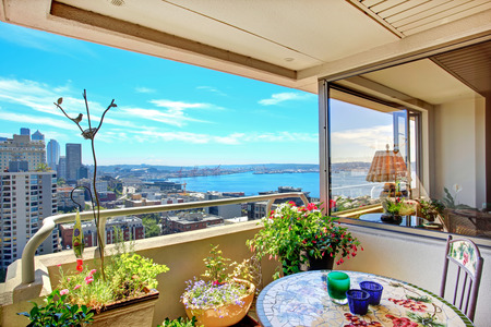 Walkout deck with with flowers overlooking scenic view of downtown of Seattle photo