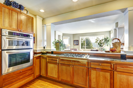 appliances: Wooden kitchen cabinets with steel appliances Stock Photo