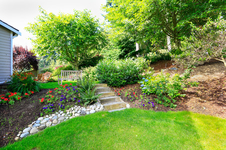 stone steps: Home outdoor rest area on backyard with bench and beautiful landscape