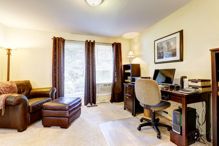 Luxury office room with leather chair, wooden desck  and cabinets photo
