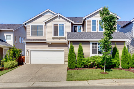 curb: Clapboard siding house. Garage with driveway and curb appeal. Stock Photo