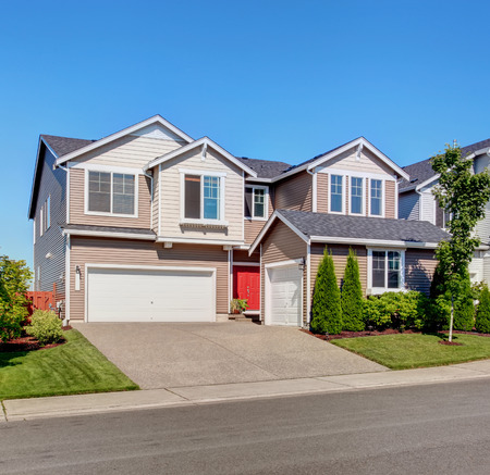 garage on house: Clapboard siding house. Garage with driveway and curb appeal. Stock Photo