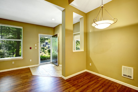 open floor plan: Empty apartment with open floor plan. Entrance hallway with open door and tile floor