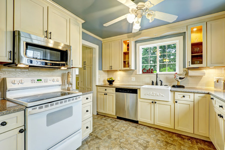 appliances: Kitchen room interior with granite tops and steel appliances. Countryside house Stock Photo