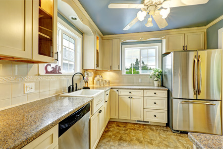 back kitchen: Kitchen room interior with granite tops and steel appliances. Countryside house Stock Photo
