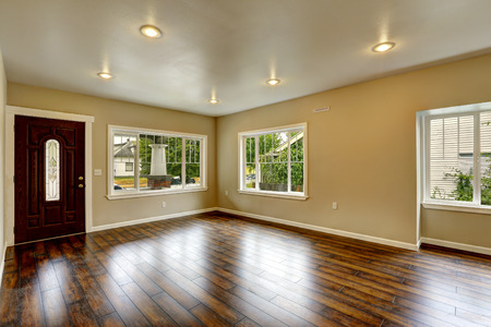 hardwood: Empty house interior. Spacious living room with new hardwood floor and ivory walls