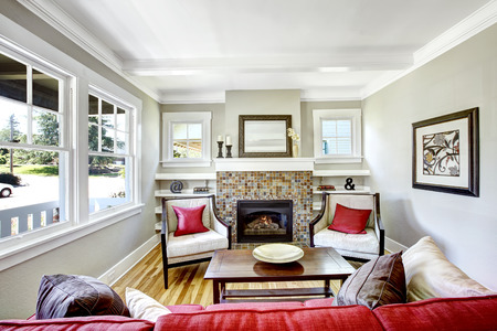 fireplace living room: Cozy small living room with fireplace.  Room decorated with brown and red pillows