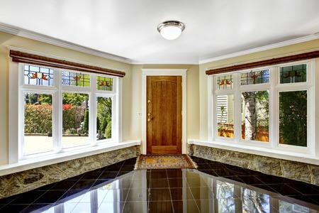 shiny floor: Luxury interior. Foyer with black shiny tile floor, large windows  with stone windowsill base trim