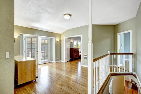 upstairs: Upstairs room with walkout deck and staircase in empty house