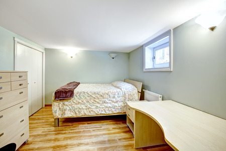 bedroom: Bedroom interior. Mother-in-law apartment. Furnished with bed, desk and dresser
