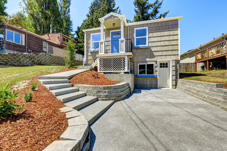 concrete: Clapboard sidinig house with walkout deck and concrete walkway