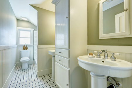 bathroom design: White bathroom interior with siding wall trim, two washbasin stands and cabinet