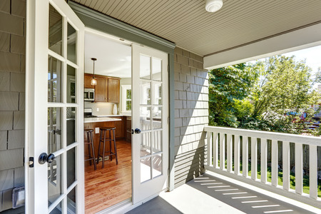 french doors: Kitchen room with exit to walkout deck with railings.