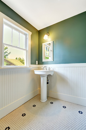 white trim: White bathroom interior with white and green wall trim. White washbasin stand