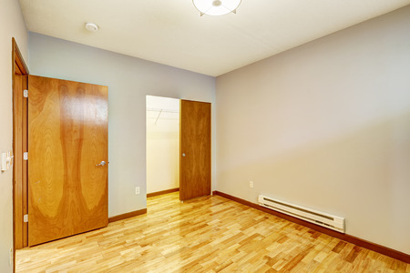 walk in closet: Empty apartment interior. Room with walk-in closet and shiny new hardwood floor Stock Photo