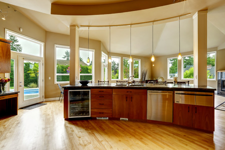 home appliances: Spacious luxury kitchen room with round kitchen island and steel appliances Stock Photo