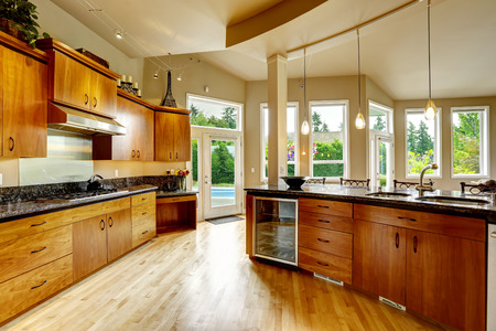 kitchen cabinets: Spacious luxury kitchen room with round kitchen island and steel appliances Stock Photo