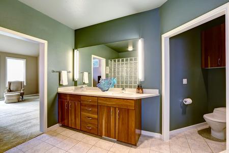 bathroom mirror: Wooden bathroom vanity cabinet with mirror.