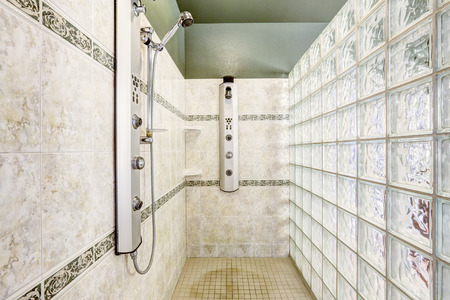 bathroom wall: Bright open shower with glass block wall and tile trim